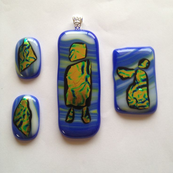 New.. Three Part sets: Matching pendant, broach and earrings. Dichroic gold, green and blue, in a blue wavy glass base. $100.00AUD the set.