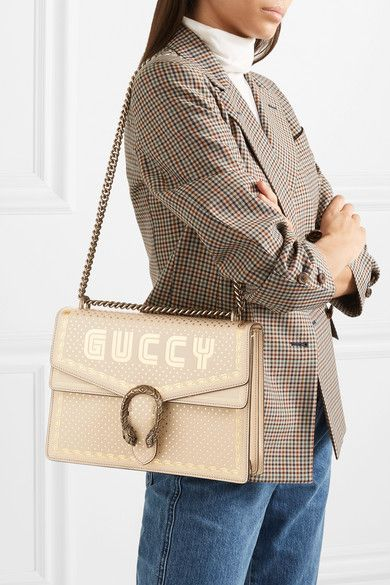 961c5ffa3e6 GUCCI Dionysus printed leather shoulder bag.  Guccy  is the medieval  version of the label s name - the knock-off logo is printed in SEGA® s  iconic font on ...