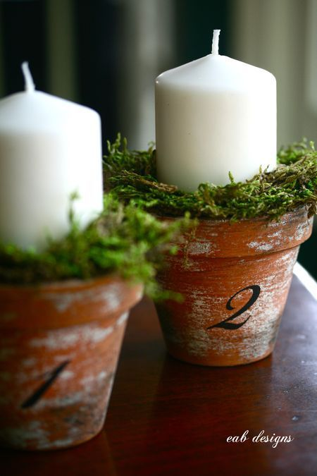 DIY aged terra cotta pots with numbers and pillar candles