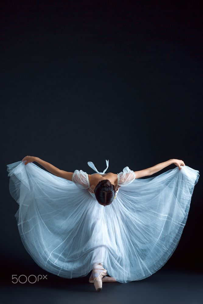Portrait of the classical ballerina in white dress on black background by Volodymyr Melnyk on 500px