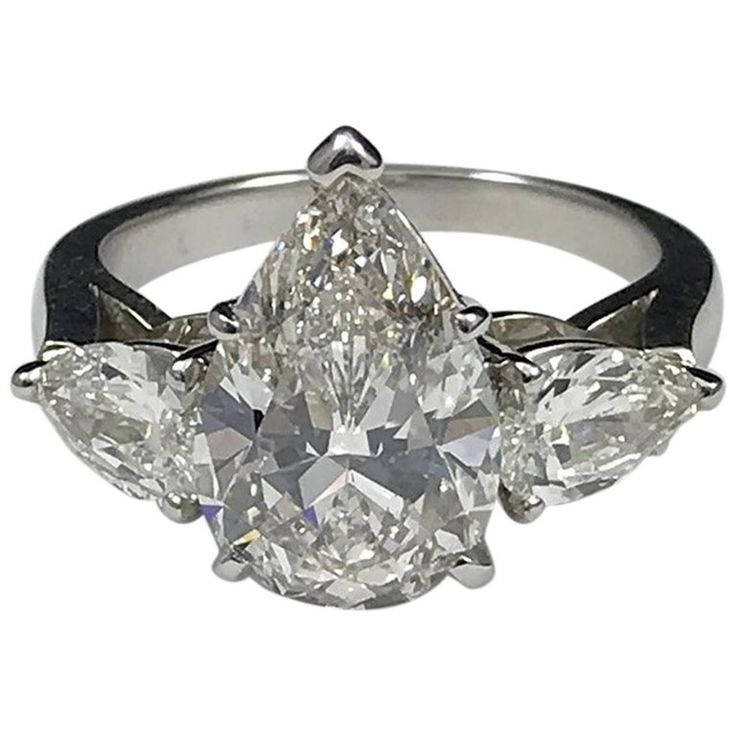 GIA Certified 4.03 Carat G VS1 Pear Shaped Diamond Ring | From a unique collection of vintage three-stone rings at https://www.1stdibs.com/jewelry/rings/three-stone-rings/