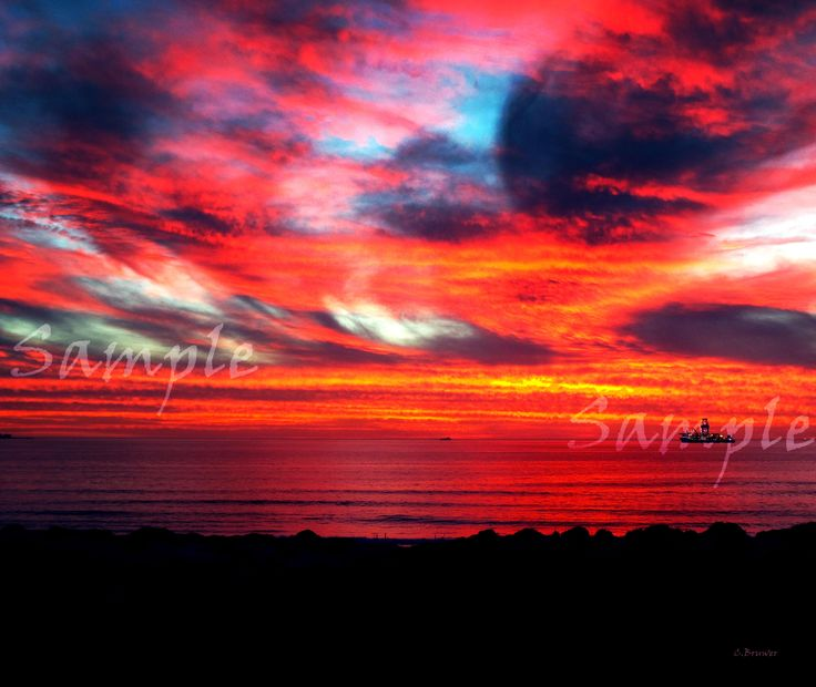 Click on image to view non sample version.  Amazing spectacle of mother nature showing off her beauty. A sunset never to be forgotten at Dolphin Beach in Cape Town South Africa.