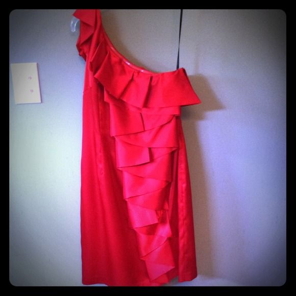 Red Calvin Klein Dress Calvin Klein one shoulder red dress. Fabric is polyester but a silky feel. So cute on! Calvin Klein Dresses