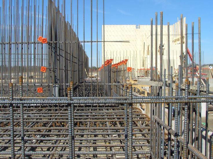 Note the orange safety caps on the exposed vertical rebars to prevent impalement.