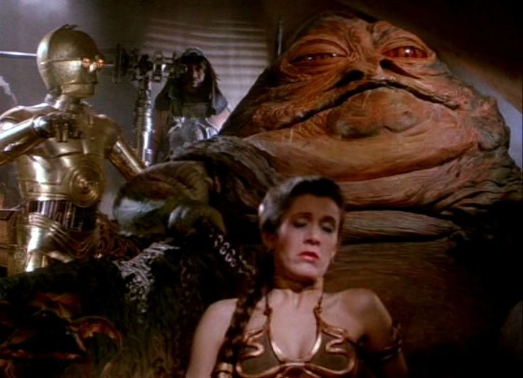 Jabba the Hutt & C3PO - Star Wars - on the thought of puppets, we begin to cross from puppet to costume. Jabba seems to be mostly puppet, just a large one. Someone is moving his mouth, eyes, arms etc. C3PO is more of a costume, someone just walking around as him.
