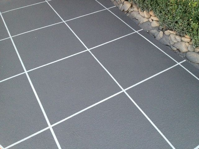 Black stencilled concrete driveway stairs and pathway for How to clean off spray paint on concrete