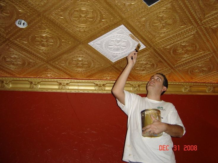 He presses styrofoam tile onto the ceiling. The end result? I had no idea THIS was possible!