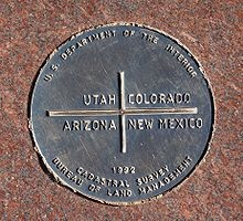 """Bucket list! Be in four places at the same time. A bronze disk reading """"U.S. Department of the Interior – Utah, Colorado, Arizona, New Mexico – 1992 – Cadastral Survey – Bureau of land Management"""""""
