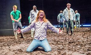 Manic … Leo Bill as Bottom, centre, in A Midsummer Night's Dream at the Young Vic, London.