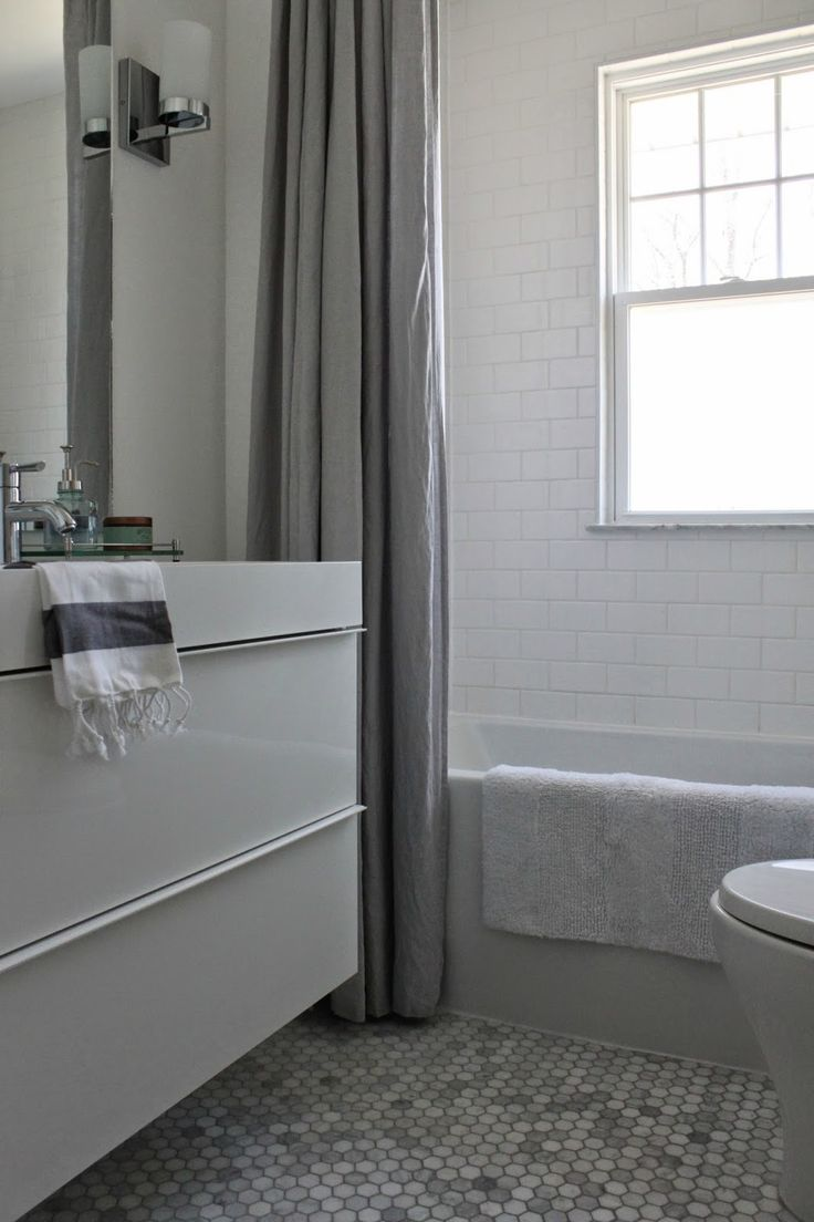 Modern jane bathroom renovation marble hexagon and white subway tile ikea godmorgon vanity - Ikea bathroom tiles ...