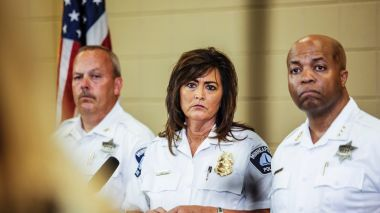Police Chief Janee Harteau, centre, has resigned following the death of Justine Damond.
