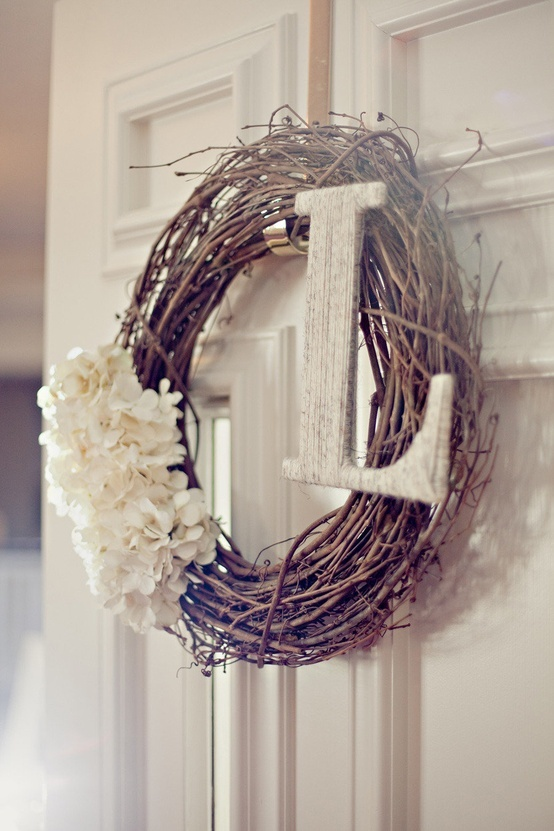 Spring wreath...Use a grapevine leaf with sweet white flowers and a white washed initial for a vintage front door.
