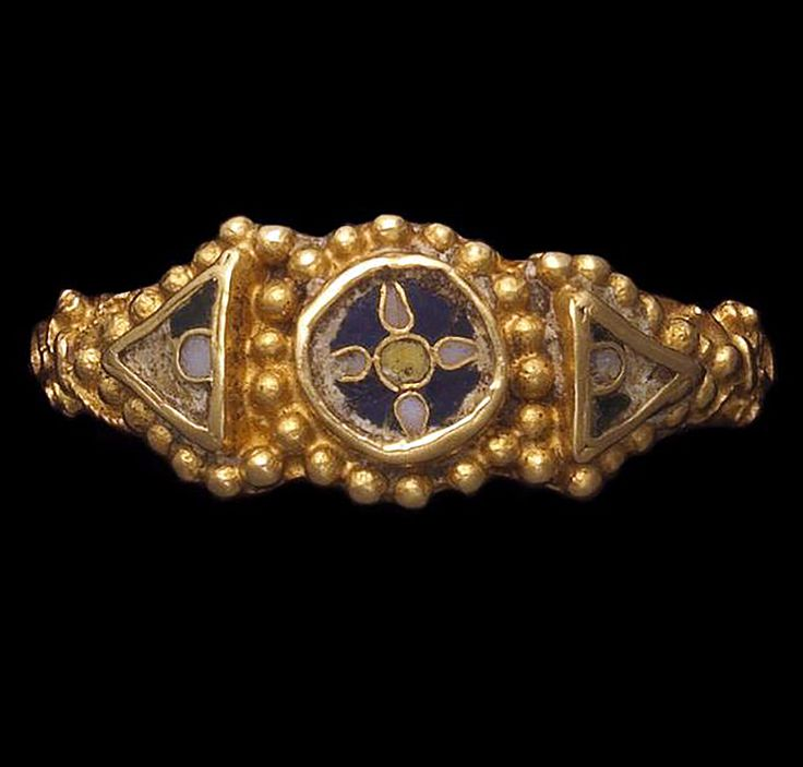 An Anglo-Saxon gold and enamel ring Circa A.D. 850-950