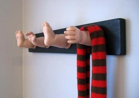 Doll parts and a piece of wood are all you need to make a hilarious (and slightly disturbing) coat rack. | 23 Silly DIY Projects That Will Make You Laugh Out Loud