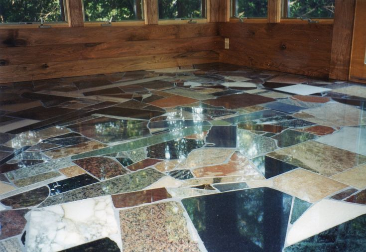 Try using off cuts of marble worktops to create this.