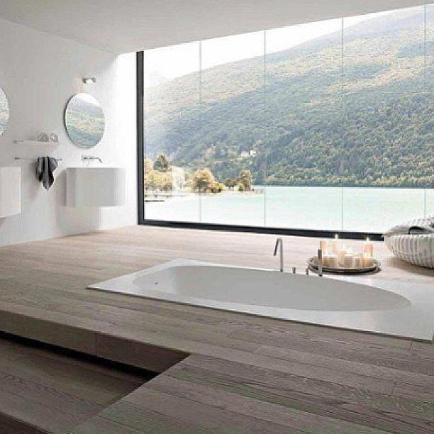 The wooden planks and gorgeous view make this sunken tub seem like it's on a deck.  Source: Instagram user epichomes