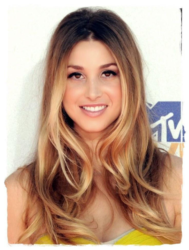 Ombre hair styles are all about amplifying hair's natural tendency to be darker at the roots and lighter on the ends. With a warm base that graduates subtly into long blonde highlights, Whitney Port perfects a soft take on the Hollywood hair trend.