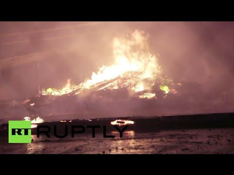 Baltimore Riots: Buildings on fire, stores looted, state of emergency de...