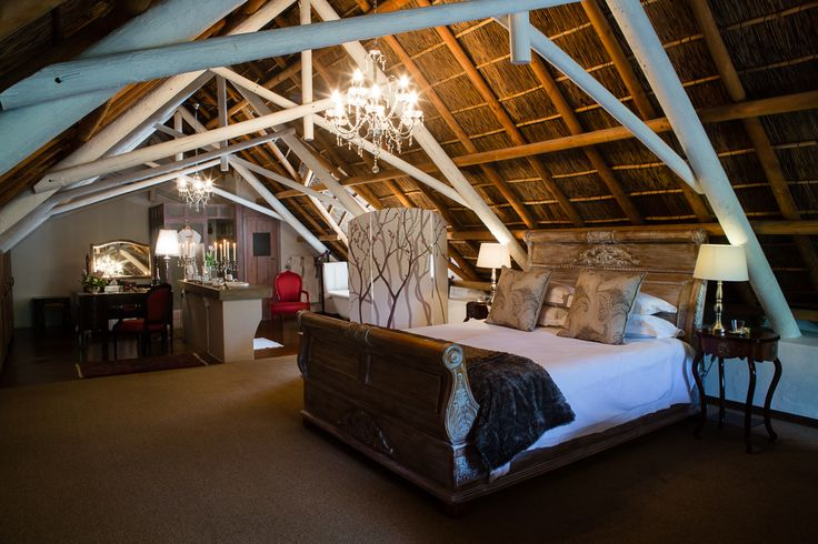 Executive Suite/#Honeymoon room 5 has a private staircase leading to views of mountains and the pecan nut tree orchard. This extremely spacious room has a thatch roof, king size Sleigh bed, air-conditioning, coffee & tea facilities, fully stocked mini-bar and percale linen.