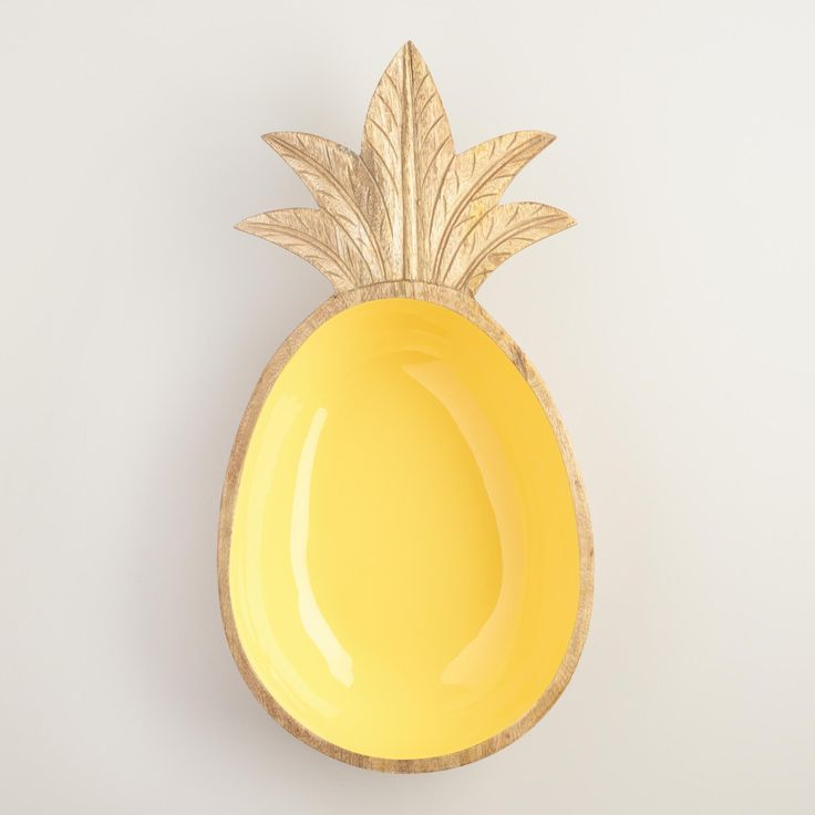 Crafted of mango wood with carved details and a pineapple yellow interior, our exclusive serving bowl is a fun display for tossed green or fruit salads. www.worldmarket.com #CelebrateOutdoors