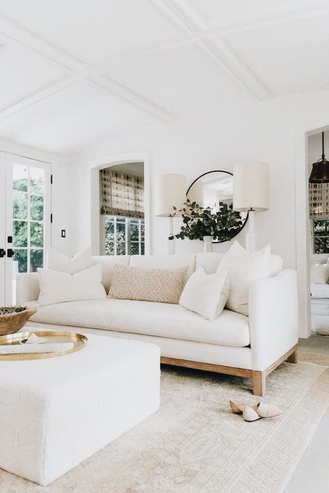 Amazing ottoman with creamy white sofa for making a space seem larger than it is and classical cozy charm.
