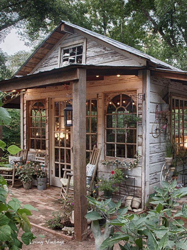 Amazing Garden Shed created with vintage windows, salvaged wood and vintage decor.  Featured at the Vintage Inspiration Party at KnickofTime.net