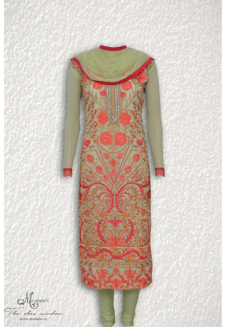 Elegant pistachio green suit adorn in all over embroidery highlighted with kundan work at neckline