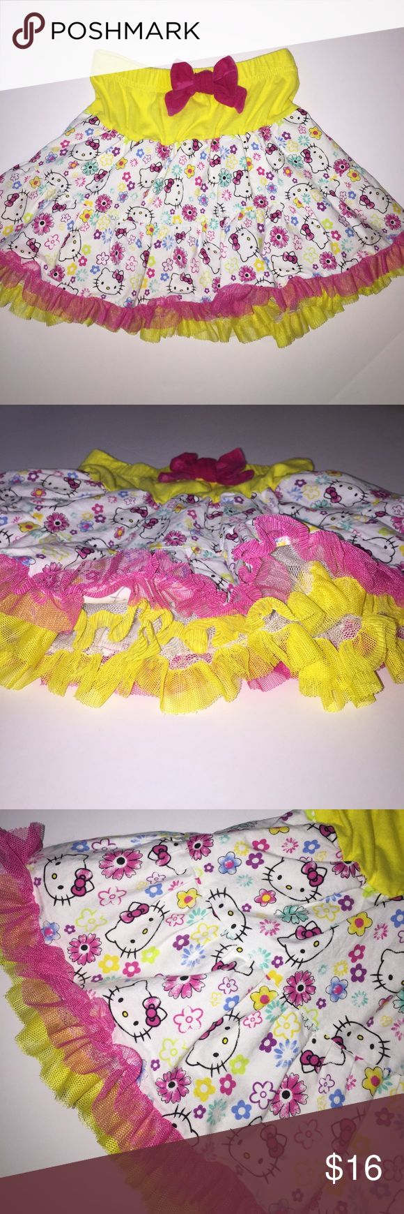 Gorgeous Hello Kitty tutu skirt size 5 excellent! This adorable hello kitty skirt has a cute hello Kitty print with flowers and elastic pull on skirt with pink bow. Tutu Ruffle hen. 3 Layers of Tulle for major Twirl factor. Excellent Condition Size 5 Hello Kitty Bottoms Skirts