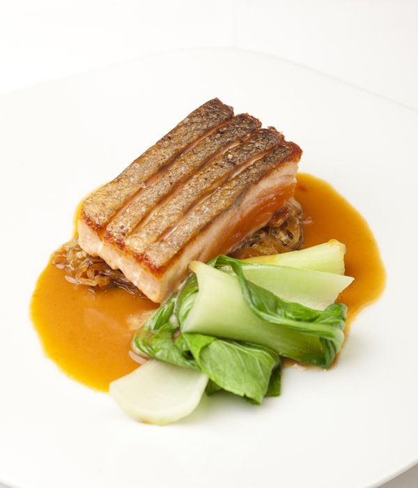 Inspired by Matthew Tomkinson's time at Ockenden Manor, this salmon with cabbage recipe was originally devised by chefs Nico Ladenis and Martin Hadden.