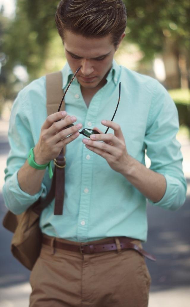Lighter khakis, mint shirt, dark brown belt, sperrys