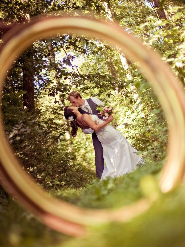 bride and groom through ring, love this idea!