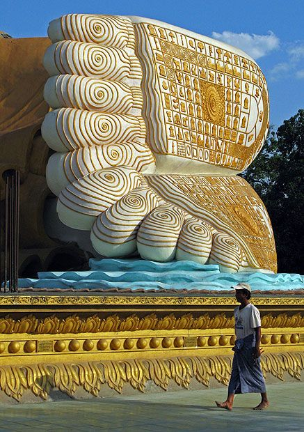 Ornate feet at Bago, Myanmar by John Harwood