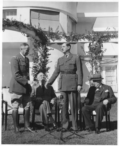 Franklin D. Roosevelt with Henri Giraud, Charles DeGaulle and Winston Churchill on the lawn of the Anfa Hotel, Casablanca.