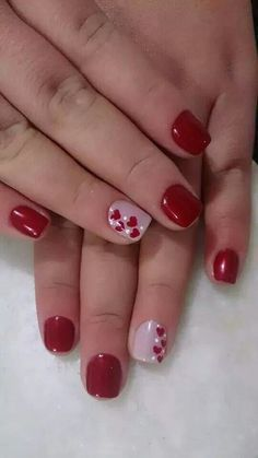 Pretty red with heart nails.