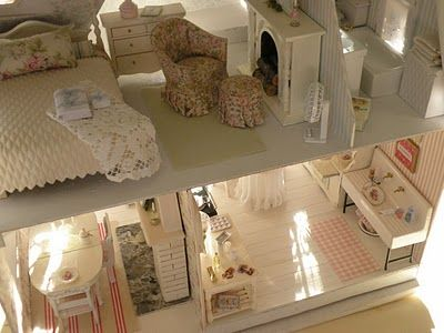 An amazing, awe-inspiring miniature dollhouse... I am in the process of building an Orchid Dollhouse Kit myself, and will be trying to model my home after this shabby chic miniature home :-)