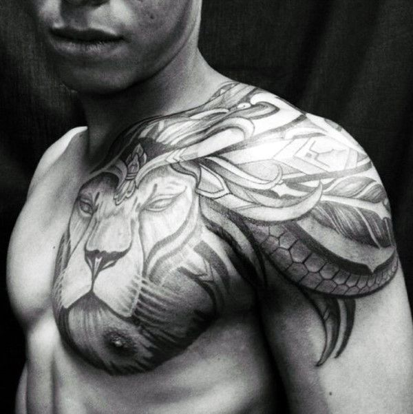 Creative Male Lion Chest And Shoulder Tribal Tattoos