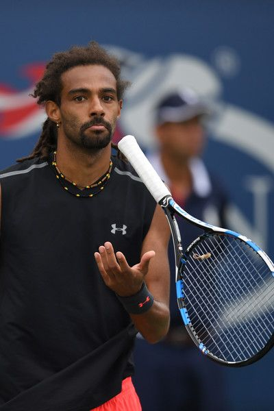 Germany's Dustin Brown gestures during his tennis match against Spain's Roberto Bautista Agut in their Qualifying Men's Singles match at the 2017 US Open Tennis Tournament on August 31, 2017 in New York. / AFP PHOTO / Eduardo Munoz Alvarez