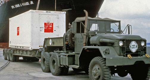 An M-52 Truck, Tractor, 5 ton, 6x6 (M39 series) towing a semi