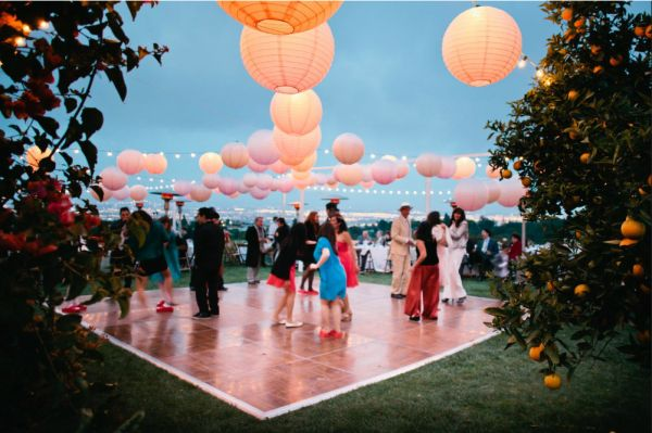 Rent a dance floor for outside wedding reception, hang lanterns