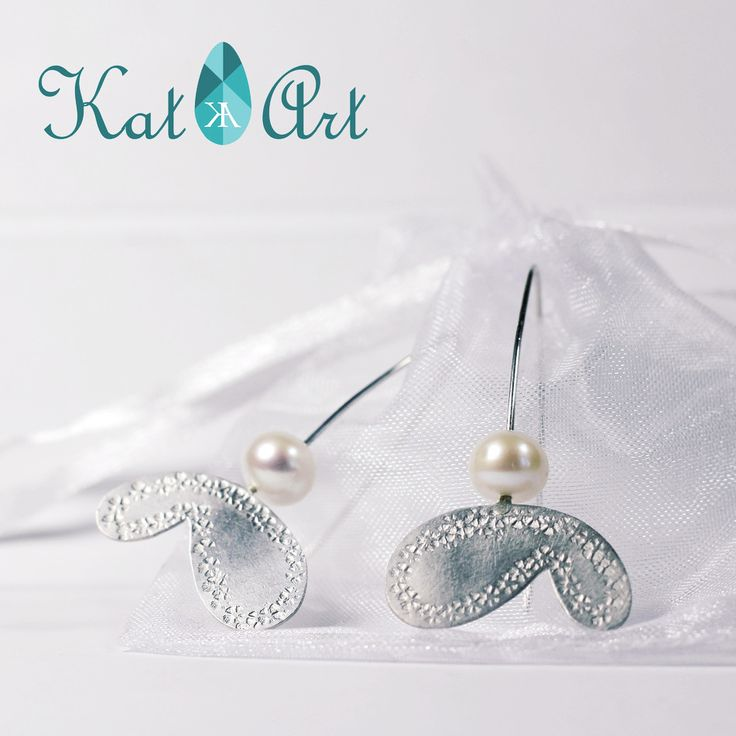 Butterfly earrings ordered by a friend made of Sterling silver and natural pearls.