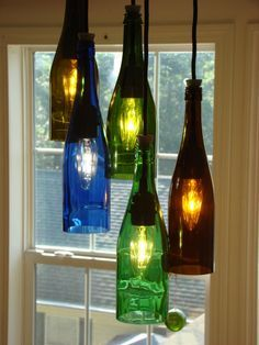 Cascading wine bottle chandelier can be purchased at http://www.etsy.com/shop/glow828