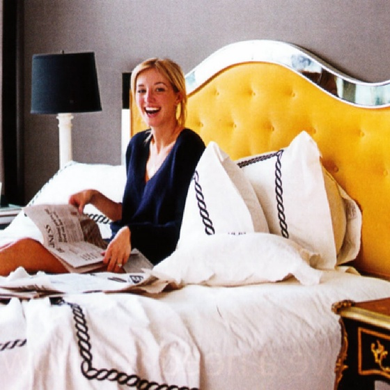 sasha alder and her amazing mirrored yellow tufted headboard in house beautiful, march 2010.