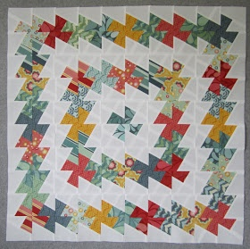 Simple Twister Quilt - Tutorial shows the simple layout for a merry-go-round twister quilt. Really cute!
