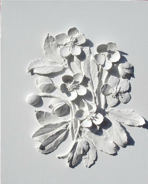 Delicate plaster casting over real flowers