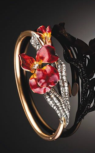 Antique enamel pansy diamond bracelet Antique French enamel pansy, rose cut diamonds, gold and silver bangle. Late nineteenth century.