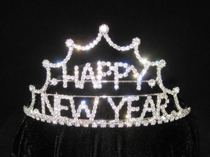 """"""" Happy  New  Year  """"  Crystal  Rhinestone  Tiara  - $16.95 each This  Tiara  measures  2 1/2"""" high x  5 1/2"""" wide.   New  Year's  eve  is  a  special  night  to  sparkle  &  shine so welcome  in  the  New  Year  while  wearing  this  sparkling  Happy  New  Year  Tiara  because  your  special ! For  more  info  please  contact   Shoot  for  the  Moon  Jewelry  Designs  (850) 230-9983  #happynewyear  #tiaras"""