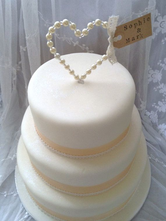I love how delicate yet simple it is with the pearl heart and the ribbon around the cake