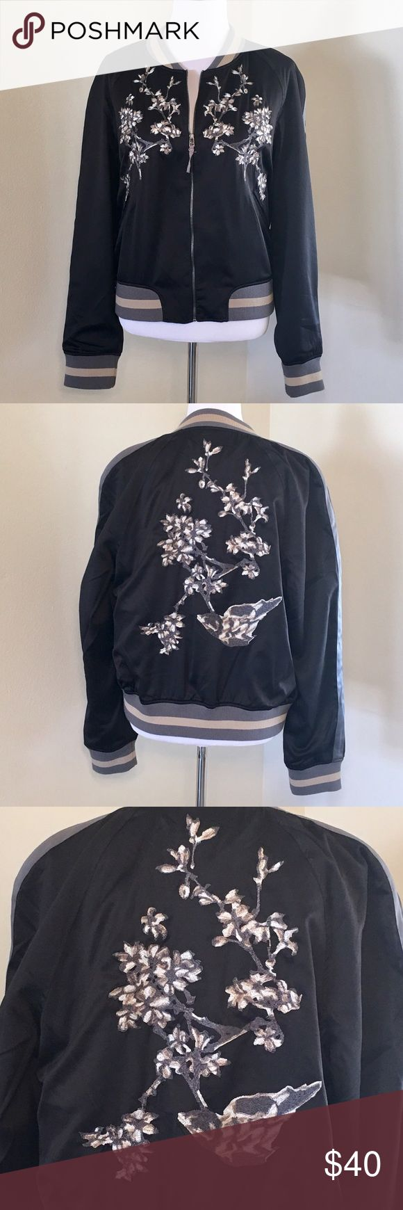 """Groovy Monkey Black Satin Bomber New with tags. Black satin. Grey and tan cuffs. Embroidered floral pattern in white, tan and grey. Two front pockets. Black satin inside. 100% polyester. Size Large. L24"""". Armpit to armpit flat 22"""". Such a groovy brand and a groovy bomber🙌🏼 No trades. No lowball offers. No joke. Price is firm.😊🌹 Groovy Monkey  Jackets & Coats"""