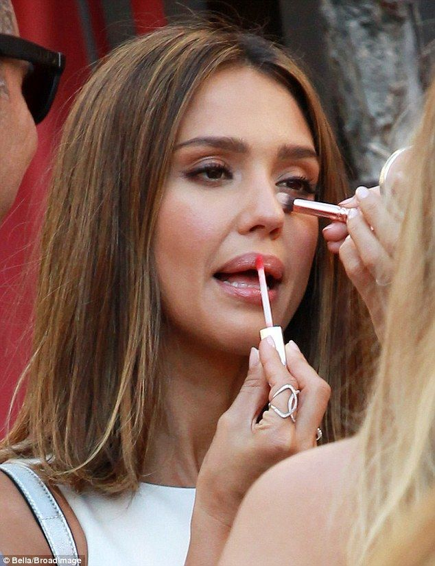 No privacy needed: Jessica Alba put on gloss as her assistant added concealer while promot...
