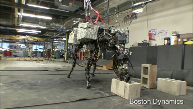 Boston Dynamics_BigDog grabs a cinder block from the floor using its new arm attachment